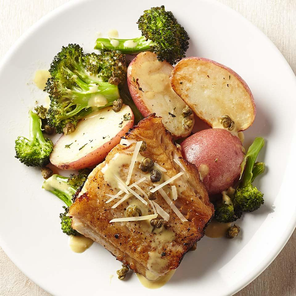 In this healthy, 30-minute fish recipe, cooking the fillets skin-side down makes it easy to keep them intact when you flip them. Be sure to pat the fish dry before cooking--it's the key to getting the skin crispy.