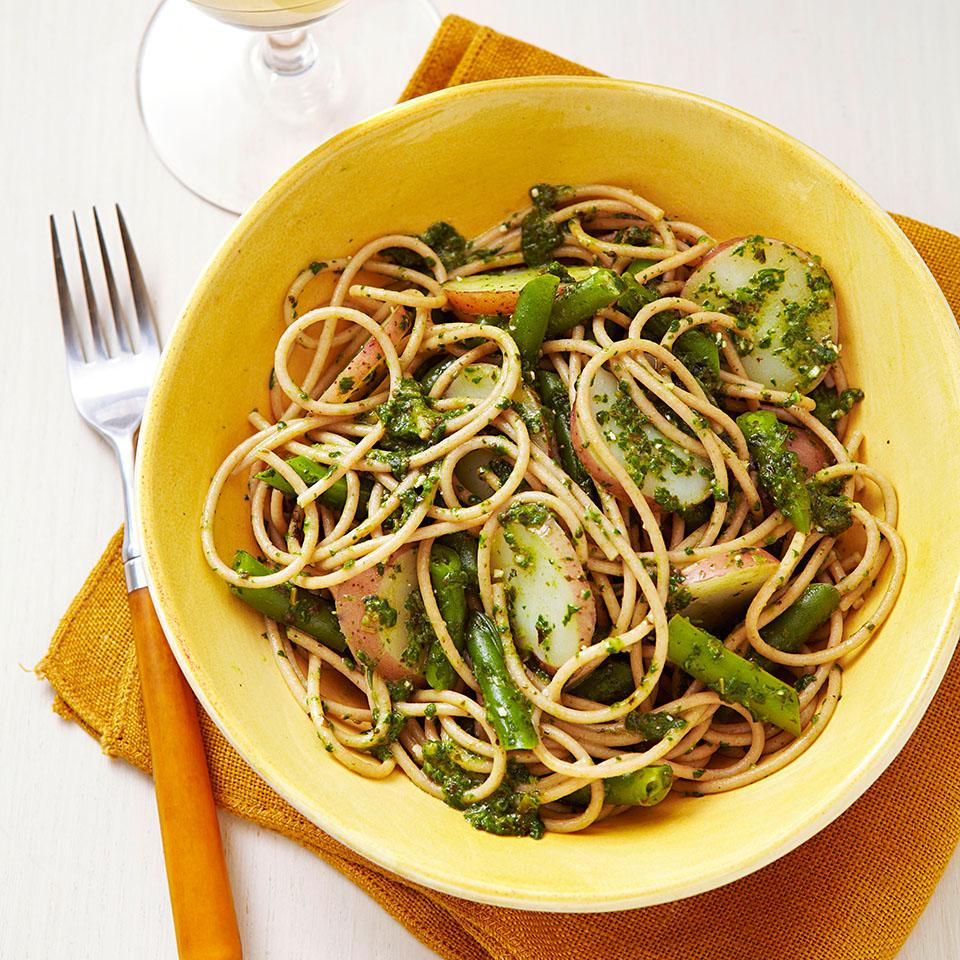 Traditionally, this Italian pasta recipe combines pasta and pesto with potatoes and green beans. In our recipe for Spaghetti Genovese we give pesto a nutritional boost by adding spinach and toss it all together with fiber-rich whole-wheat pasta for a warm, comforting weeknight meal. Serve with escarole and radicchio salad. Source: EatingWell Magazine, September/October 2012