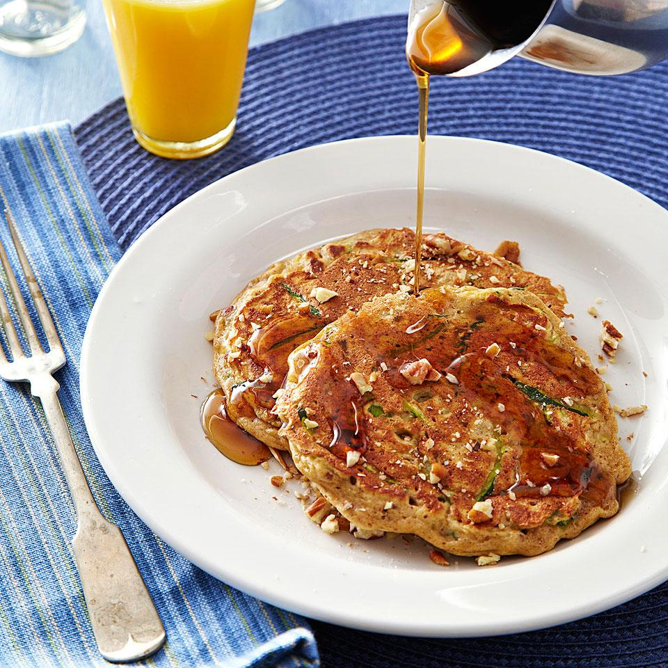 This zucchini pancake recipe marries the warm-spiced flavors of zucchini bread with the ease of quick and healthy whole-grain pancakes. When topped with maple syrup and pecans, these zucchini bread pancakes make an irresistibly delicious breakfast. If you don't have pumpkin pie spice, use 1/2 teaspoon cinnamon, 1/4 teaspoon ground ginger and 1/8 teaspoon each ground nutmeg and cloves. Source: EatingWell Magazine, July/August 2013