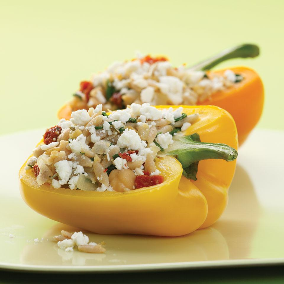 We steam brightly colored bell peppers in the microwave to save time and then stuff them with orzo, spinach and feta. This basic recipe will work with almost any filling--try substituting different types of cheese, herbs or beans. Serve with whole-wheat pita bread and cucumber salad.Source: EatingWell Magazine, March/April 2009