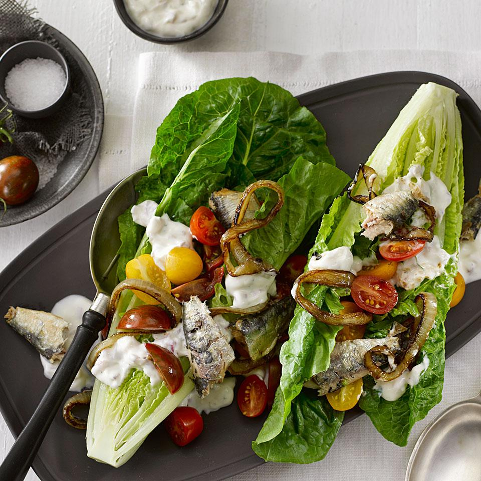Don't be afraid of the sardines in this healthy wedge salad recipe. Sardines are extremely nutritious, and are a perfect match for winter greens. In this healthy wedge salad recipe we've made little boats out of hearts of romaine lettuce and filled them with savory sardines, sweet caramelized onions, juicy cherry tomatoes and creamy dressing.