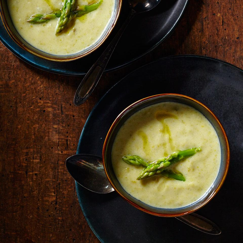 "This lemony asparagus soup is spiced with a touch of curry and gets added richness from ""lite"" coconut milk and creamy red potatoes. Top it with a dollop of crème fraîche or plain yogurt and serve warm or chilled."