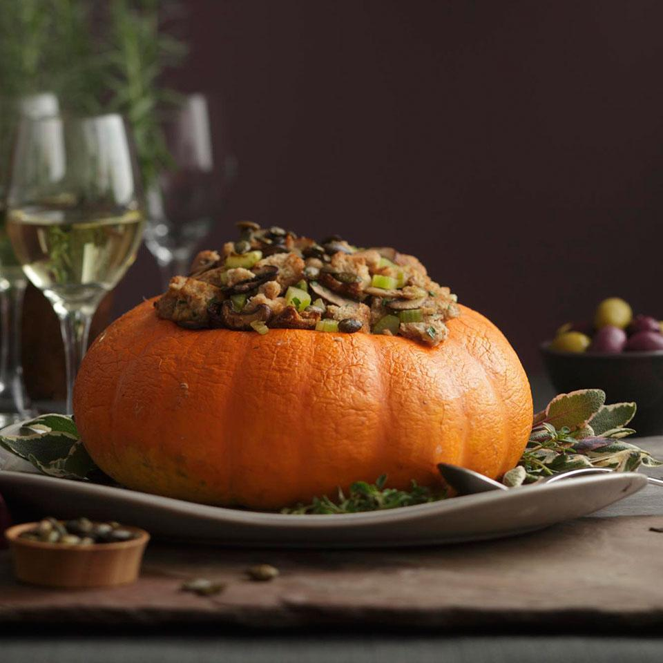 This roast pumpkin with a mushroom-and-bread stuffing is a beautiful vegetarian entree for the holidays. Use a small pumpkin if you can find one, but a winter squash like kabocha or buttercup also works. For a special garnish, save the seeds from the pumpkin, toss them with spices and roast them. If you use a squash, opt for store-bought pepitas; the squash seeds are too woody to eat. Source: EatingWell Magazine, November/December 2011