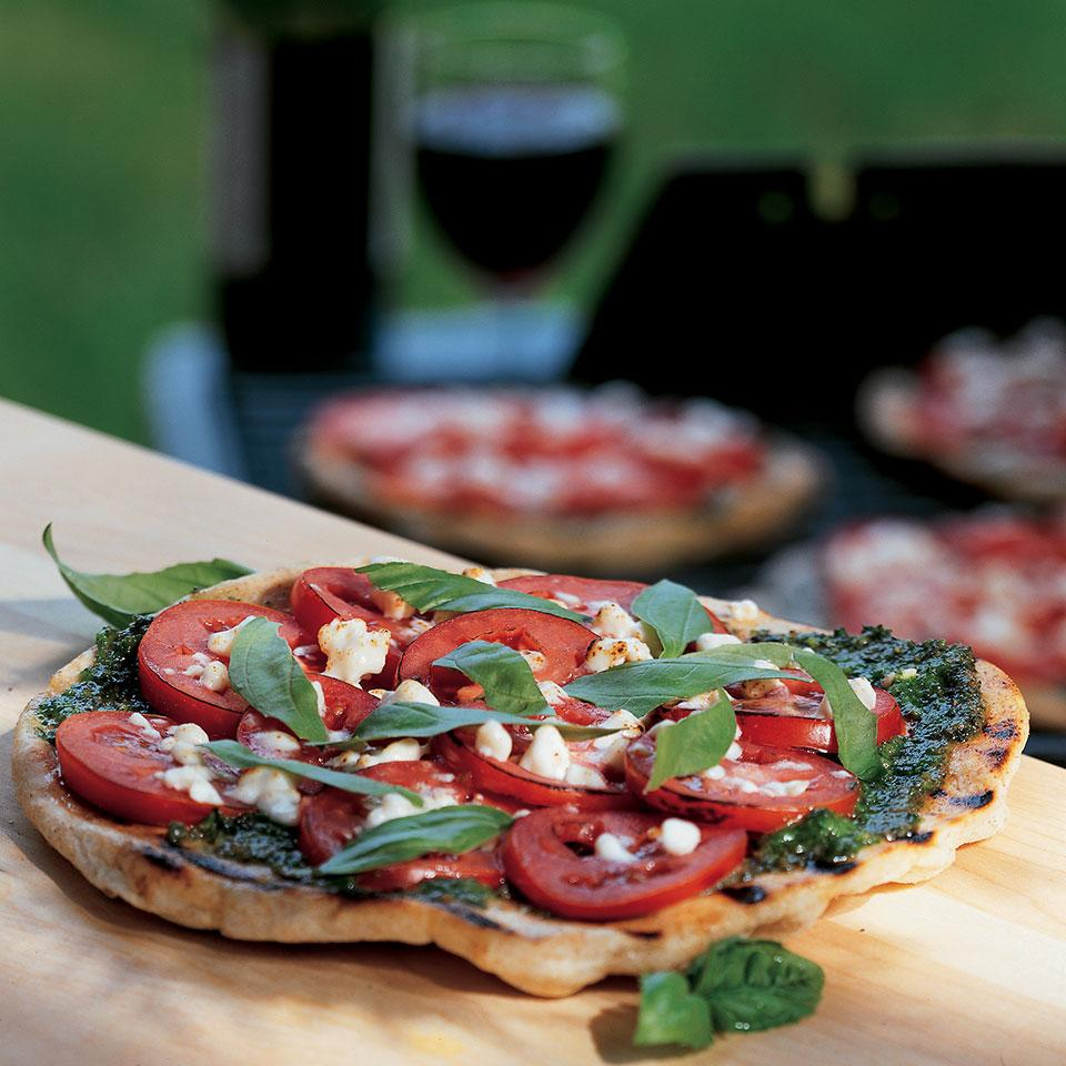Dazzle your guests, and keep the kitchen cool, by baking pizza on the backyard grill. For convenience, this recipe uses prepared pizza dough, found in most supermarkets, and pesto from a jar. Source: EatingWell Magazine, Summer 2002