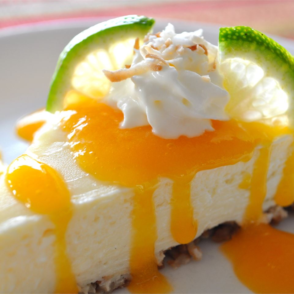 """This tropical-inspired cheesecake features a ginger-coconut crust and two divine layers topped off with a fresh mango coulis,"" says recipe creator CC<3's2bake. ""I like to make a coconut cream by adding coconut extract to whipped cream for topping the cheesecake. Top with a dollop of whipped cream and a sprinkle of toasted coconut, for even more flavor."""