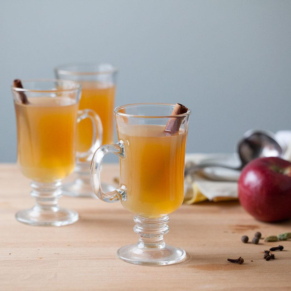 A natural, cloudy apple cider is delicious for this exotically spicy and aromatic winter warmer, but if you desire a sparkling-clear drink, apple juice can be substituted. Calvados, which is a French apple brandy, adds richness. If you wish to omit it, just add more cider or juice.