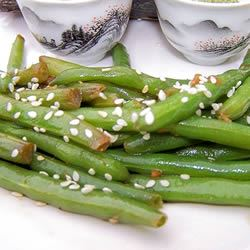 """If you're looking for a new way to serve green beans, this is it. Miso, soy sauce, ginger, garlic, and a sprinkling of sesame seeds add pizzazz. Recipe reviewer Crazy 4 Sushi says, """"The miso paste gives the sauce some body and helps with coating the beans."""""""