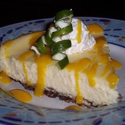 Coconut-Lime Cheesecake with Mango Coulis