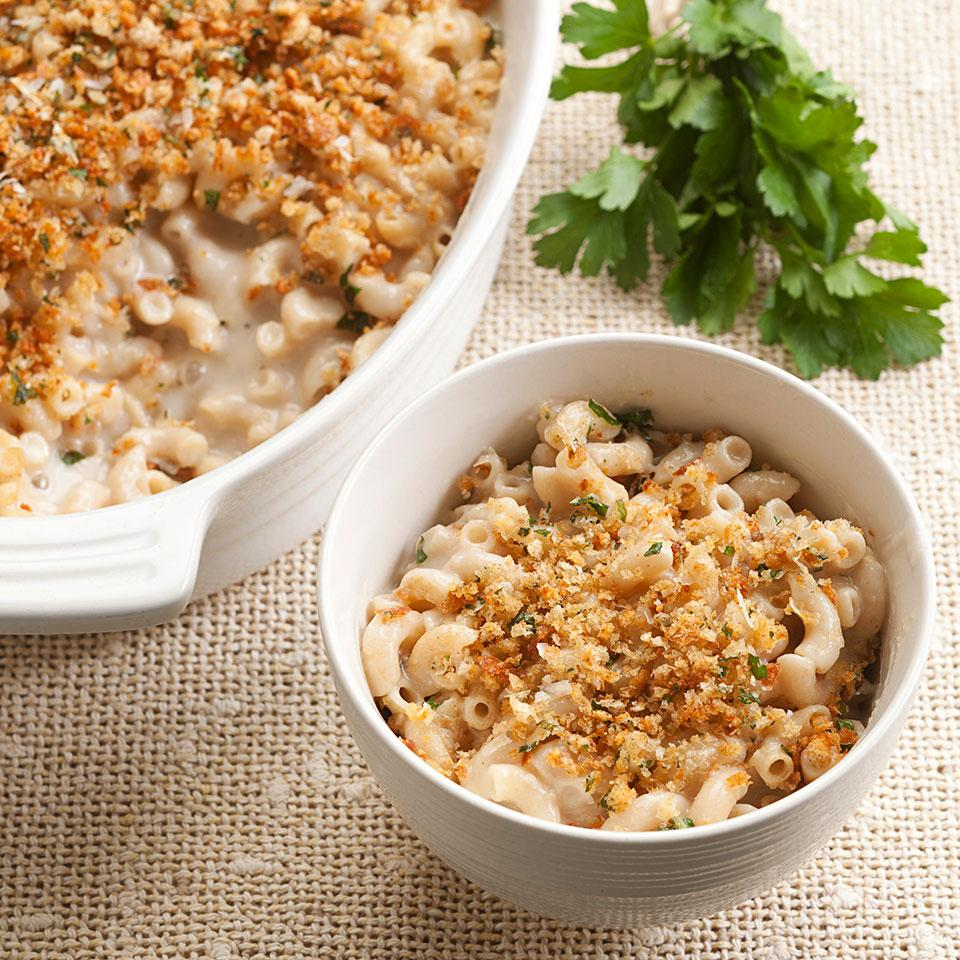 This healthy, homemade macaroni and cheese recipe is topped with plenty of golden breadcrumbs. If you want to add a little flair to this healthy macaroni and cheese, use aged Gruyere instead of Cheddar and add extra ingredients like peas, chopped cooked mushrooms or chopped ham. This recipe makes more Cream Sauce without the Cream than you'll need for the macaroni and cheese. Refrigerate or freeze the extra sauce and use it in place of heavy cream in any sauce or soup that calls for cream.Source: EatingWell Magazine, January/February 2013