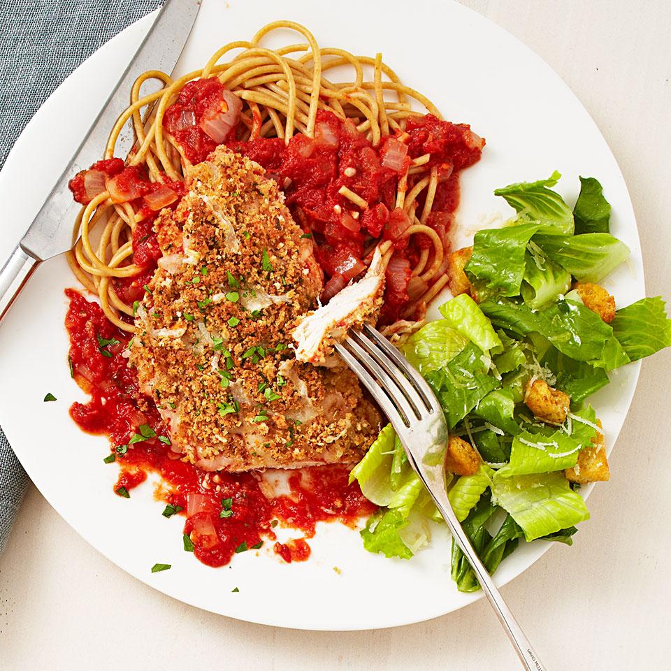 Ooey-gooey cheese, crispy breadcrumbs and plenty of sauce are the hallmarks of any good chicken Parmesan recipe, and this one-skillet version of chicken parm for two is no exception. We made this recipe easier by skipping the breading on the chicken and loading the top of the dish with cheese and breadcrumbs. Serve it with whole-wheat pasta to soak up the extra sauce. Source: EatingWell Magazine, November/December 2012