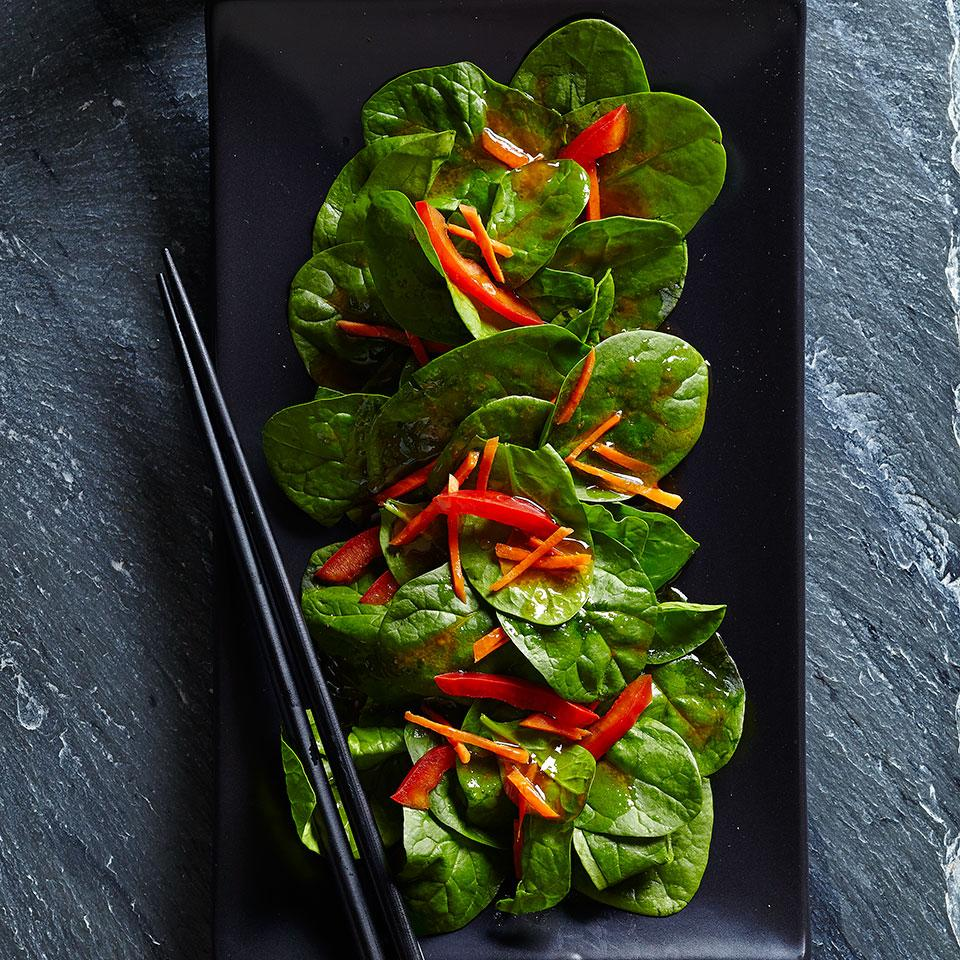 This spinach salad tossed with spunky ginger dressing was inspired by the iceberg salads served at Japanese steakhouses across the U.S.