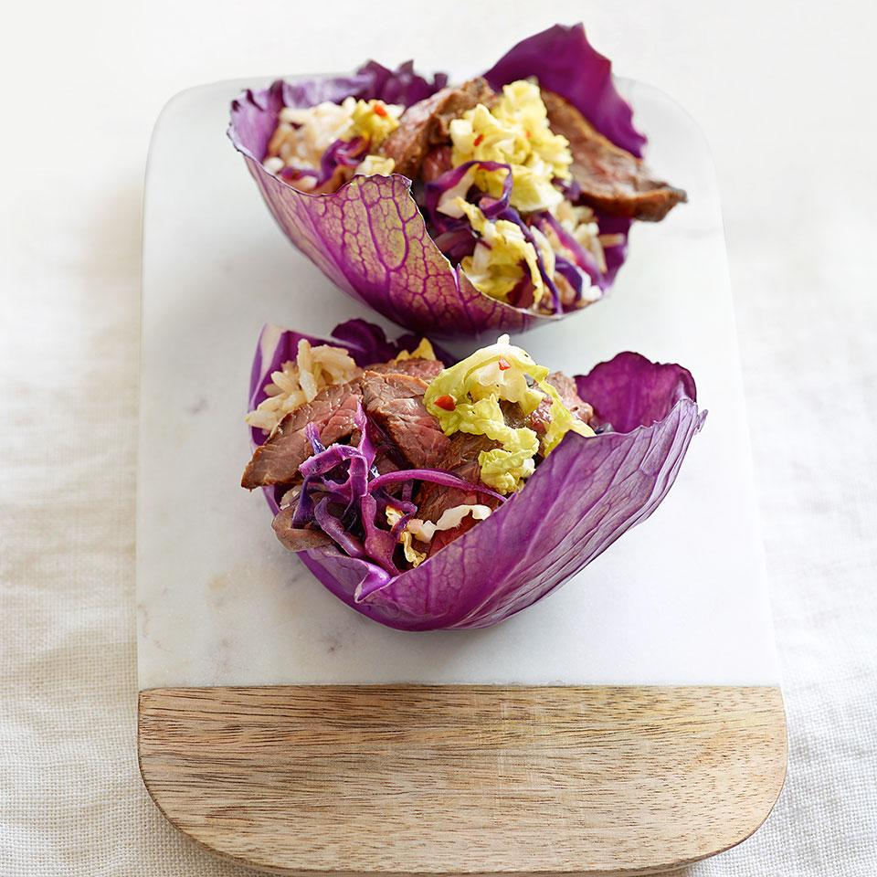 This Korean-flavored steak tacos recipe uses cabbage in three ways: a crisp cabbage leaf acts as the shell, sautéed cabbage is part of the filling and pickled cabbage tops off the tacos. You can prepare most of the ingredients ahead, so all you have to do is assemble the steak tacos when you're ready to serve.