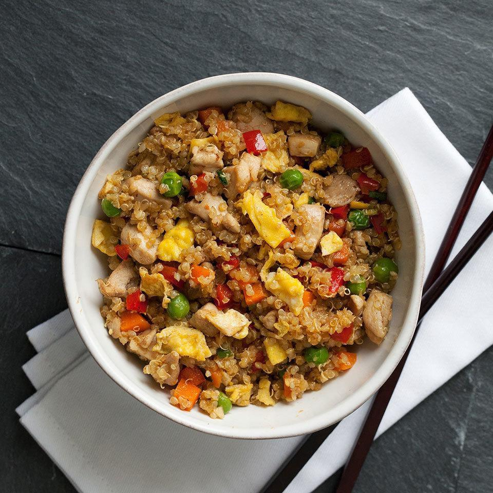 Regular fried rice gets a protein boost when rice is swapped for quinoa in this healthy dinner recipe. Feel free to use any vegetables you have on hand-broccoli, green beans and mushrooms are all good options. Serve with hot sauce if desired.