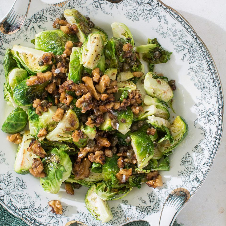 Chef Michael Symon loves Brussels sprouts because they can be cooked so many different ways. In this healthy recipe, the rich flavor of the walnuts, Dijon and capers is perfection with roasted meats.