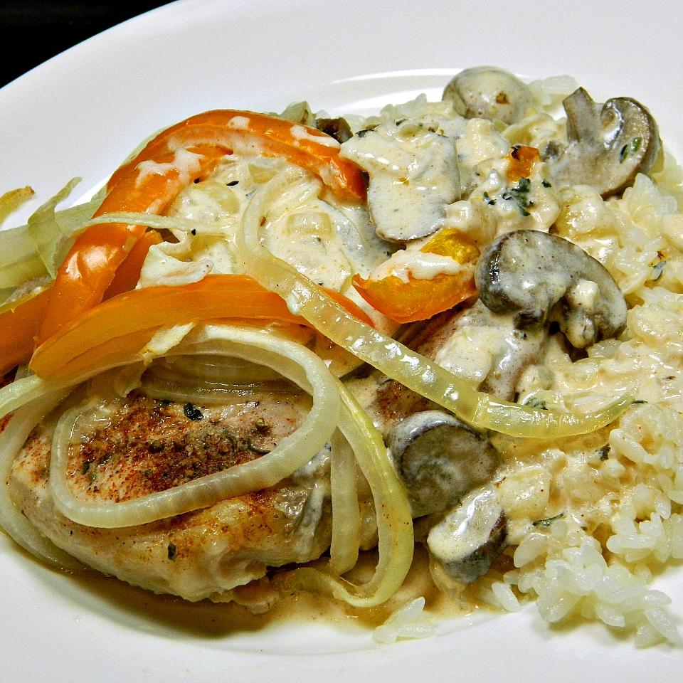 Nikki's Pork Chops with a Mushroom Cream Sauce over White Jasmine Rice Marianne