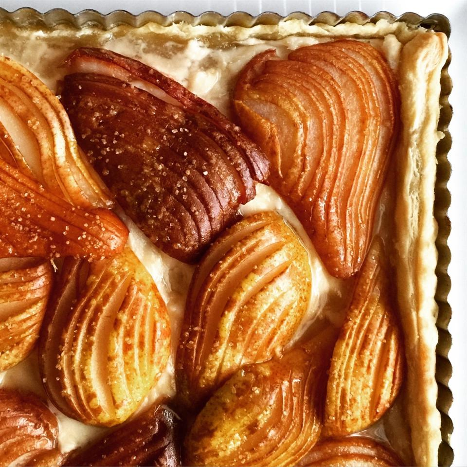 """Put seasonal pears on display at your next holiday gathering. Recipe creator Nicholio says, """"Using the Hasselback method on pears makes them even easier to arrange in this delicious fall tart."""""""