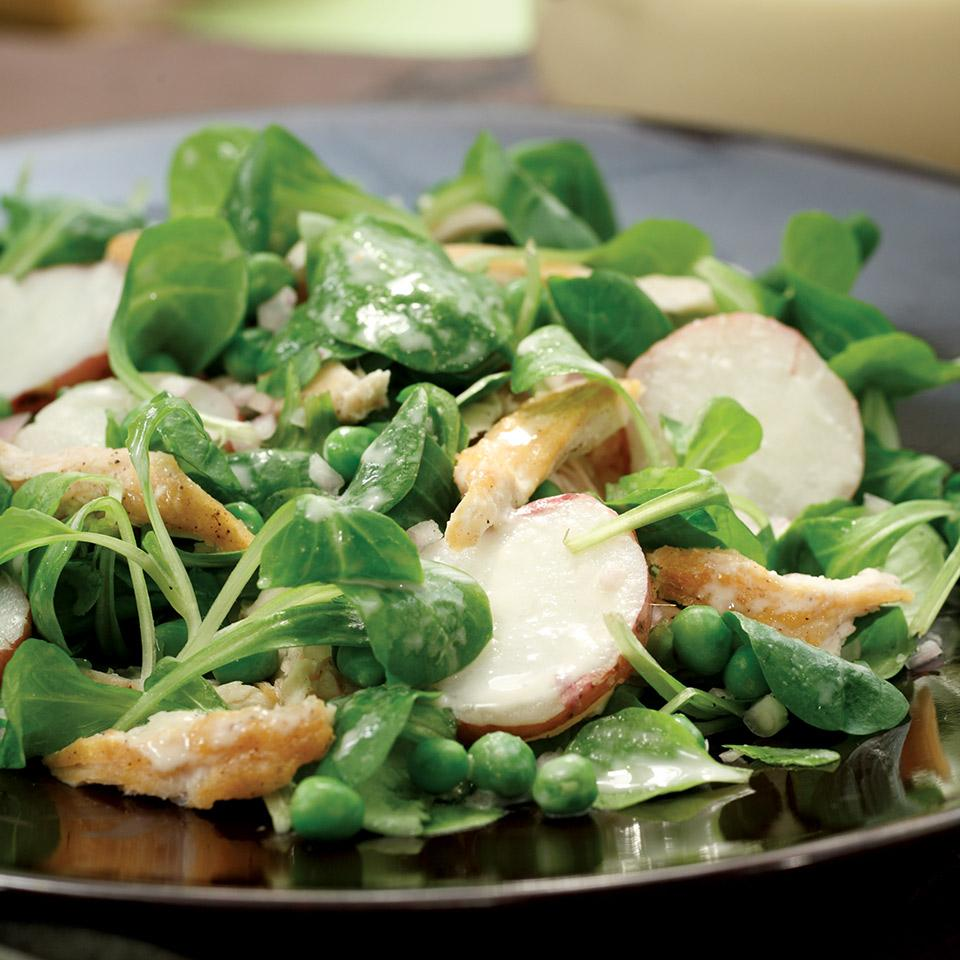 In this salad, mâche is tossed with spring ingredients--new red-skinned potatoes and fresh peas--and a lemony tahini dressing and chicken.