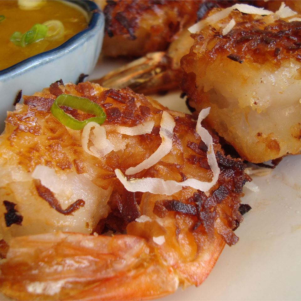"""Shrimp are coated in a thick batter, then tossed in coconut before they are fried, and then baked. """"This was a wonderful recipe!"""" says brandyceliz81. """"One helpful hint: I put the coconut in a large freezer bag (with some flour) and shook up the shrimp in the bag. It made things a little less messy."""""""