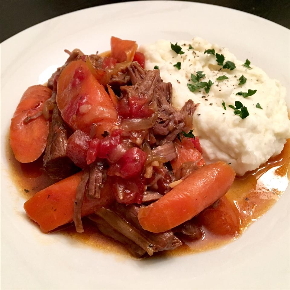"""This recipe is my personal favorite for pot roast,"" says judy2304. ""It tenderizes the toughest meats and produces a wonderful, flavorful gravy. It's best when cooked in a cast-iron Dutch oven. This is a whole meal in one pot, my favorite kind of meal."""