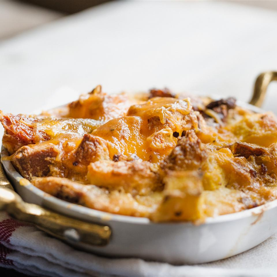 "Side dish or breakfast dish? On Thanksgiving, this bread pudding can be either. ""Cheesy, crispy, crunchy and warm! This savory bread pudding is an unexpected and delightful way to use pumpkin,"" says recipe creator RusticJoyfylFood. ""The addition of sausage makes it a main course or a hearty side dish. This dish would make a lovely addition to your Thanksgiving or a holiday breakfast table."""
