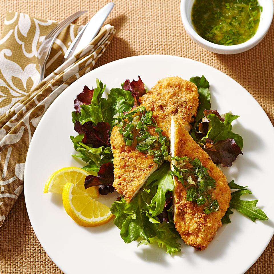 "This healthy recipe for crispy chicken schnitzel involves coating the chicken breasts with fresh whole-wheat breadcrumbs and oven ""frying"" using a mist of olive oil cooking spray instead of frying in lots of oil. Serve on a bed of mixed greens or with mashed potatoes. Source: EatingWell Magazine, May/June 2014"