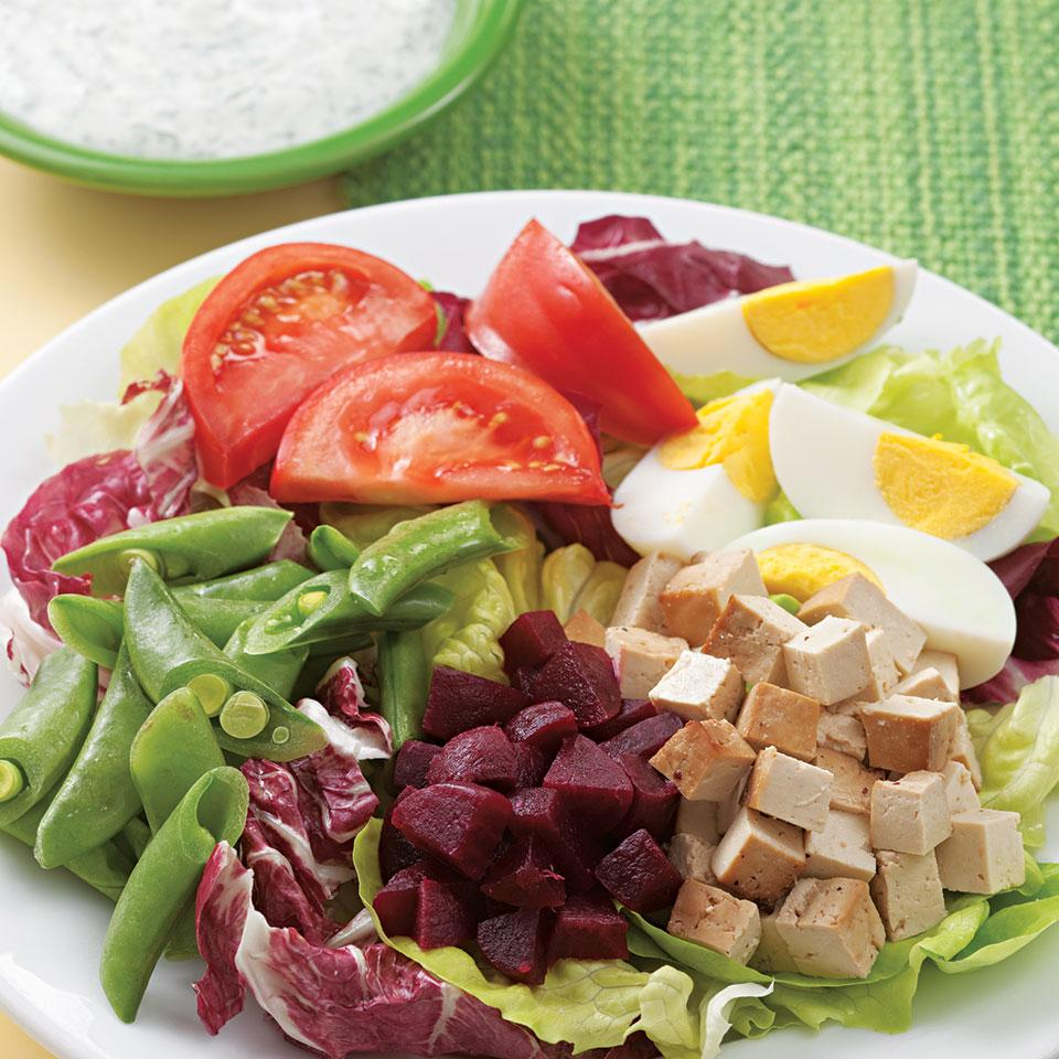 This composed salad is an artful arrangement of greens, hard-boiled egg, smoked tofu, beets and snap peas drizzled with a cool, creamy dill dressing. It's as pleasing to the eye as it is to the palate. We like smoked tofu, but any flavored baked tofu would work well in this recipe. Serve with iced tea.