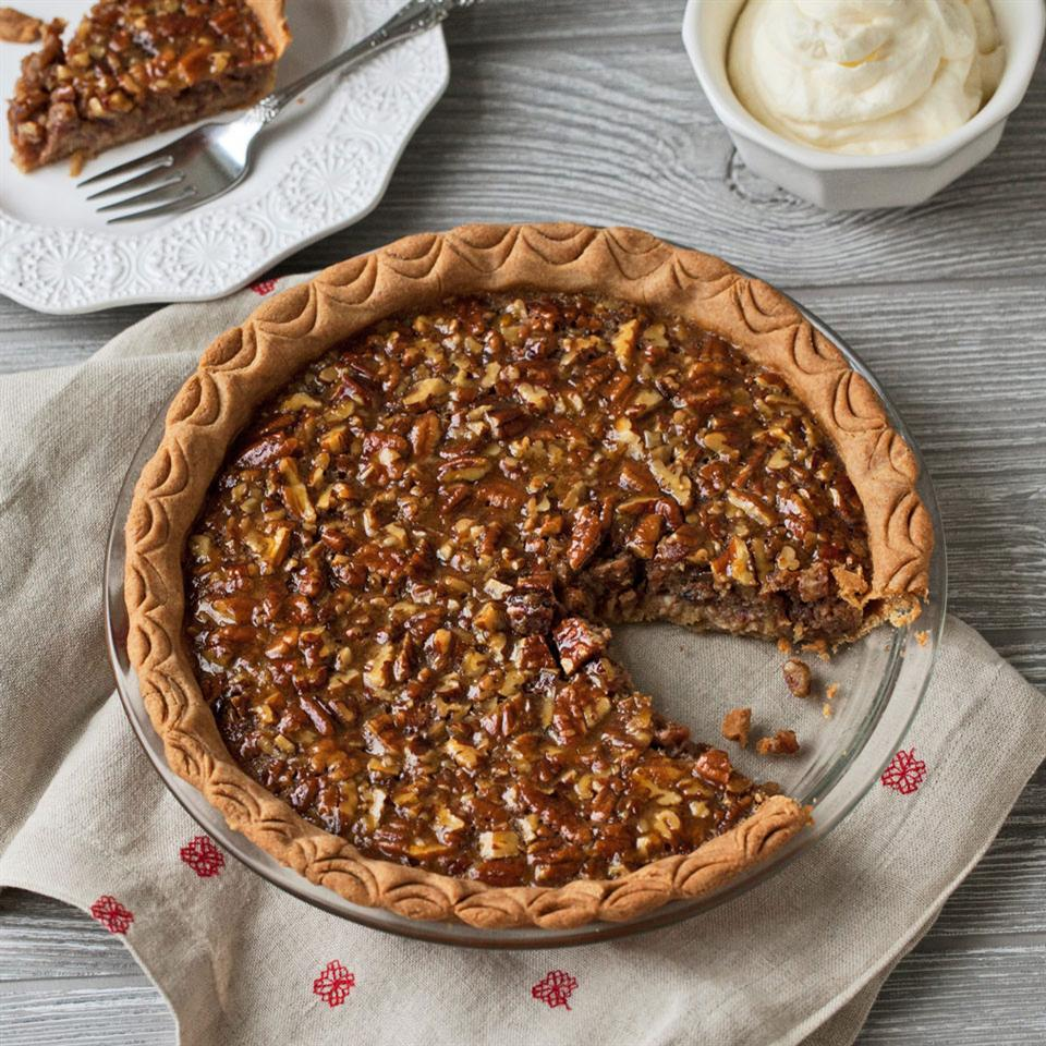 Give classic pecan pie a healthy makeover—this recipe replaces some of the corn syrup and uses a whole-wheat flour crust for a delicious dessert. Top with whipped cream to make it extra-special.