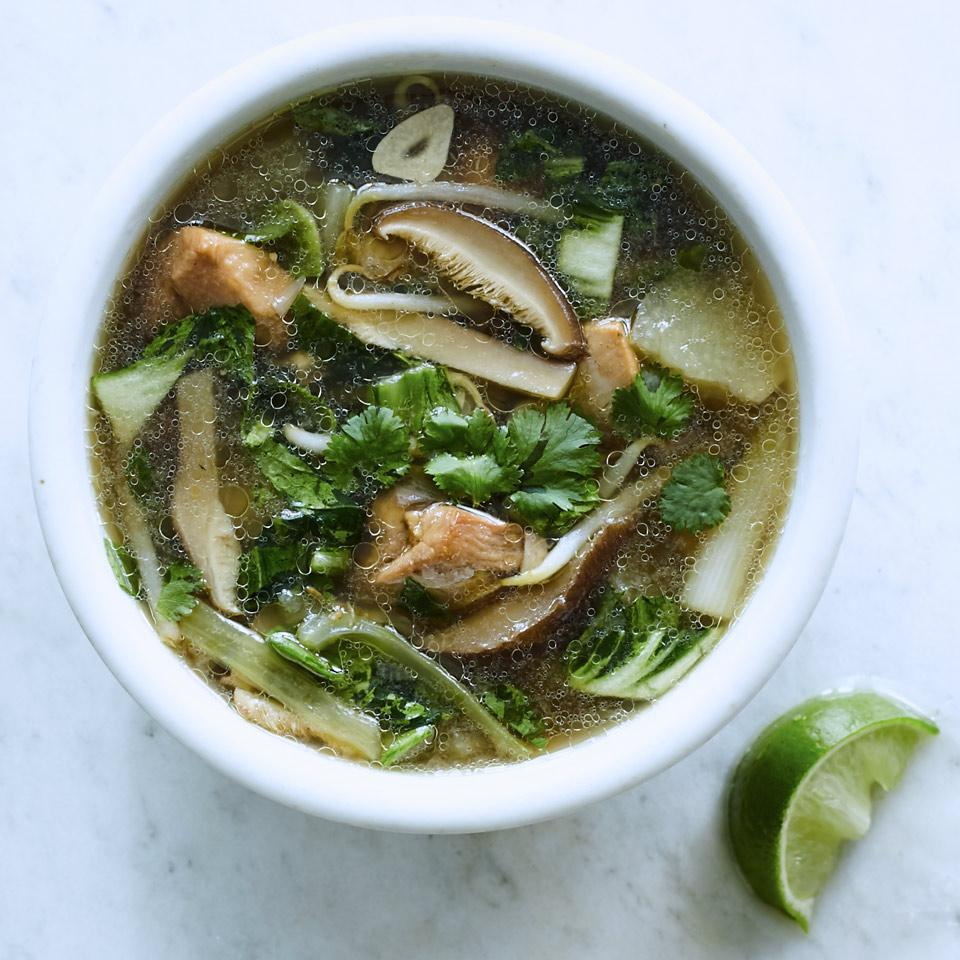 What is so obliging about this hearty chicken soup is that you can add any vegetables that suit your fancy: napa or Savoy cabbage, mushrooms, Chinese broccoli, broccolini, onions, leeks, mustard or turnip greens, celery or whatever tickles your bonnet. Just be sure that you don't overcook the vegetables. Spice it up with Asian-style chile sauce, such as sriracha, and/or serve the soup over noodles to make it a more substantial main dish.