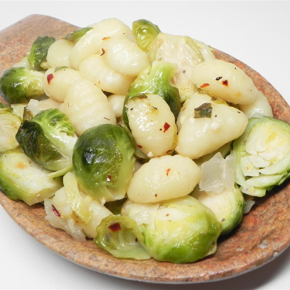 Fresh Brussels sprouts are sliced and sauteed with gnocchi, onions, and garlic in this simple weeknight dinner in a skillet. If you like, add a little cooked and crumbled bacon to the mix.