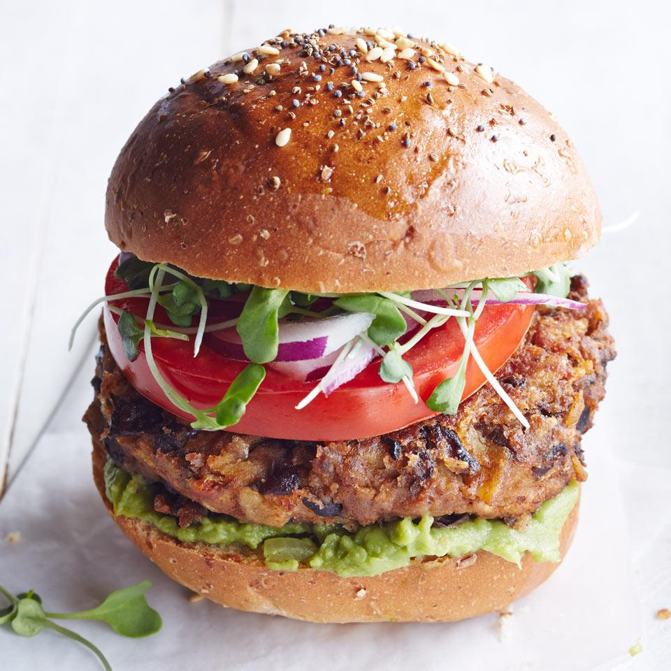 Salsa and some pantry staples give this vegetarian bean burger recipe tons of flavor. We use crushed tortilla chips to bind the burgers together, making them a great vehicle for using up those crumbs that inevitably fall to the bottom of the bag.