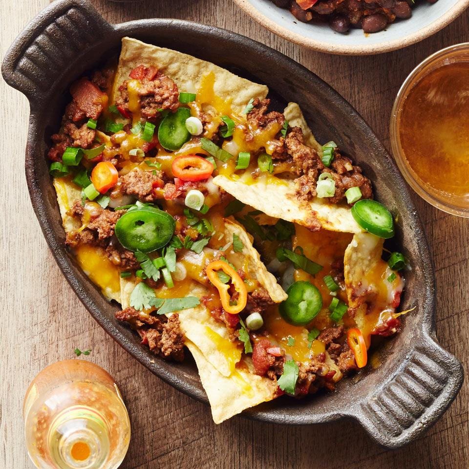 Make nachos a healthy dinner when you top them with an easy 30-minute chili. Serve this healthy recipe with sliced scallions, avocado, fresh tomatoes and sour cream, if desired. Source: EatingWell Magazine, January/February 2017