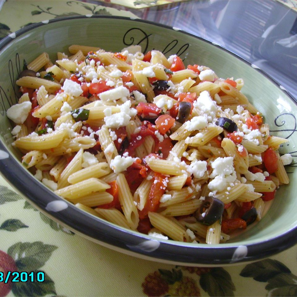 Ripe tomatoes, sun-dried tomatoes, olives, basil, garlic, herbs, and red pepper flakes are marinated in olive oil until softened, then tossed with hot pasta and topped with crumbled feta cheese for a flavor-packed pasta dish. Delicious warm or cold, it doubles as a colorful pasta salad for picnics!