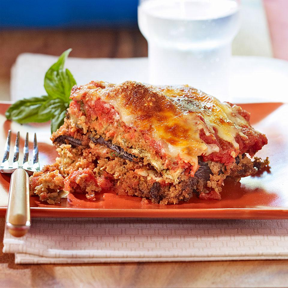 Eggplant Parmesan doesn't have to include layers of deep-fried eggplant and mountains of cheese. This healthy eggplant Parmesan recipe has is satisfying without piling on the calories and fat. Don't skip the step of salting the eggplant, especially if you want to freeze one of the casseroles. Salting helps to draw out extra moisture so the eggplant holds up better in the freezer. Serve with a salad of bitter greens tossed with a red-wine vinaigrette. This recipe makes enough for two 8-by-8-inch casseroles (four servings each)--have one for dinner tonight and freeze the other for a night when you don't have time to make dinner.