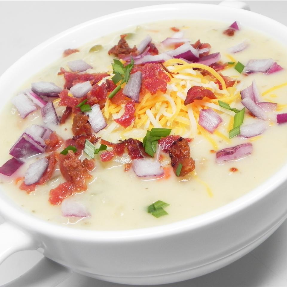 "Here's a rich and creamy soup topped with crispy bacon. Frozen hash brown potatoes really speed up the prep time. MICSHELLIE says, ""This recipe freezes well and is easily halved. Serve with shredded Cheddar cheese and garlic croutons."""