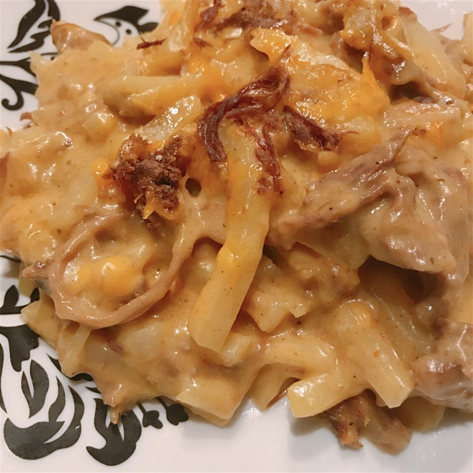 "Shredded beef, hash browns, curry seasonings, and a creamy cheese sauce create a simple, comforting casserole. Brian says, ""I used this basic recipe to use up leftover roast. It was pretty good and quick for a night we didn't have much time for supper."""