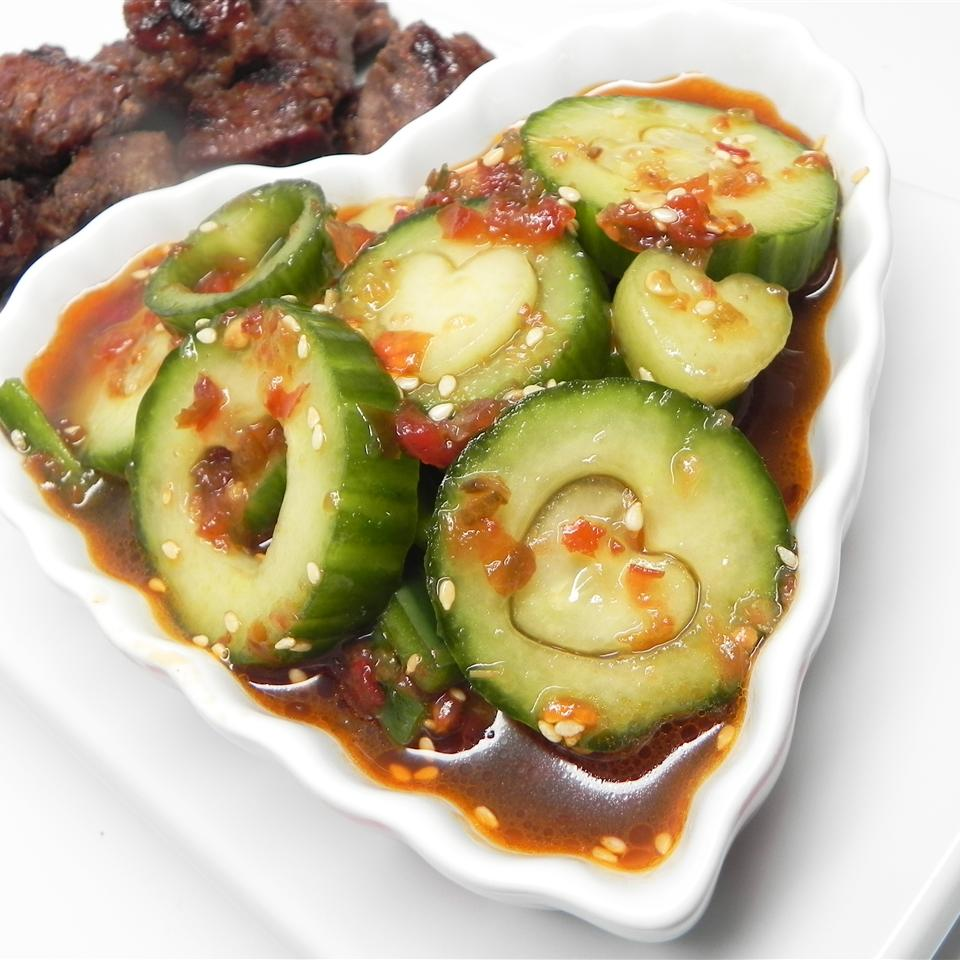 """This quick fresh pickle features cucumber slices marinated in vinegar, spicy gochujang paste, and sesame seeds. """"May be a little salty, but that is because it's meant to be eaten with rice,"""" says santokieann. """"Spices can be adjusted to your personal taste. Hope you enjoy! It goes great with bulgogi."""""""