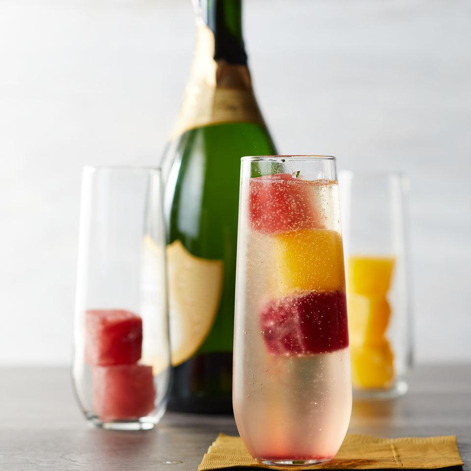 Take your mimosas to the next level with this fun hack! Make freeze juice in ice cube trays for a pretty and frosty way to add a splash of juice to your Champagne while keeping it cold.
