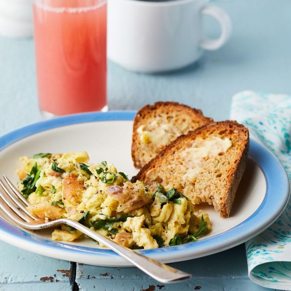 Elevate plain-Jane scrambled eggs with smoked trout and fresh spinach in this healthy breakfast recipe.
