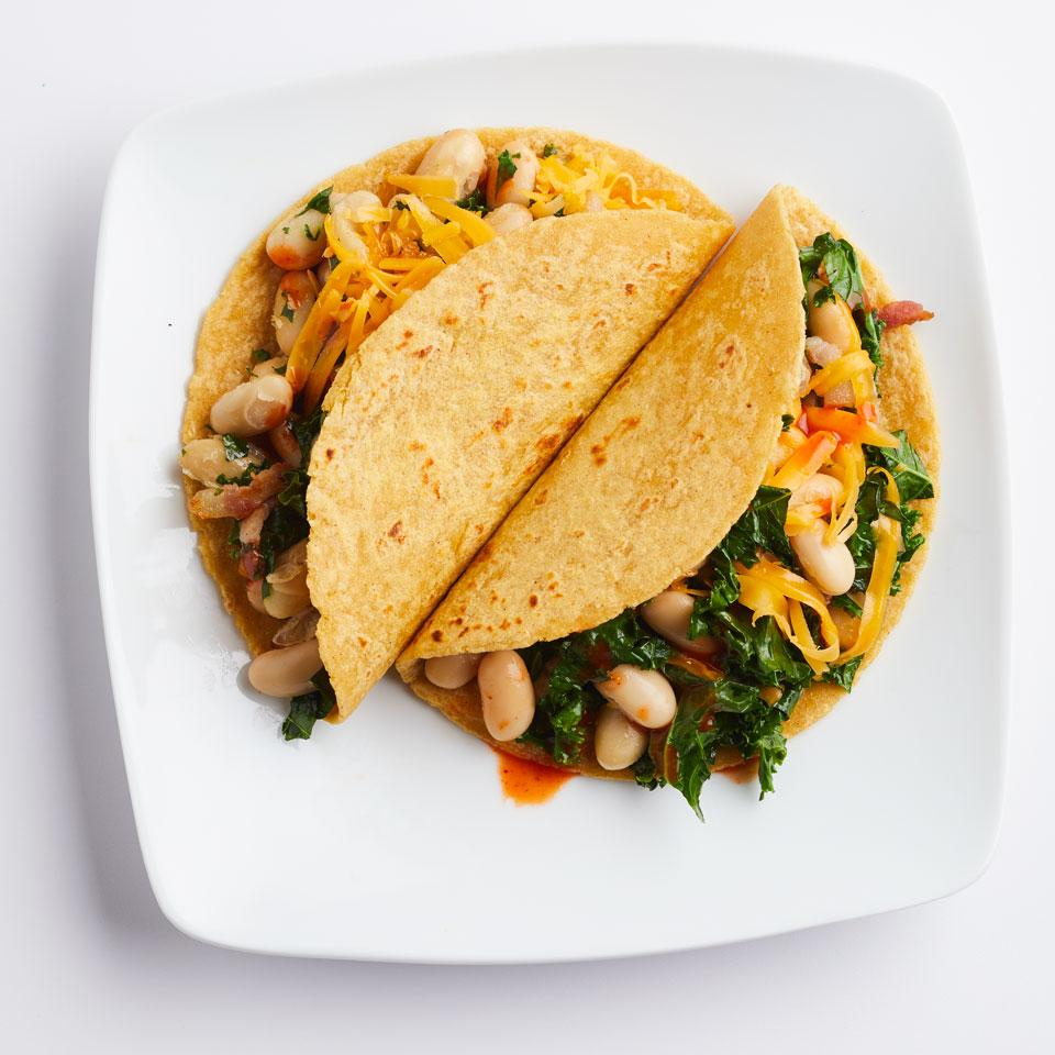 Get a serving of vegetables from kale, and protein and fiber from beans, in this healthy breakfast taco recipe. Other types of beans (pinto, black, kidney) or chickpeas also work well. Source: EatingWell Magazine, March/April 2017