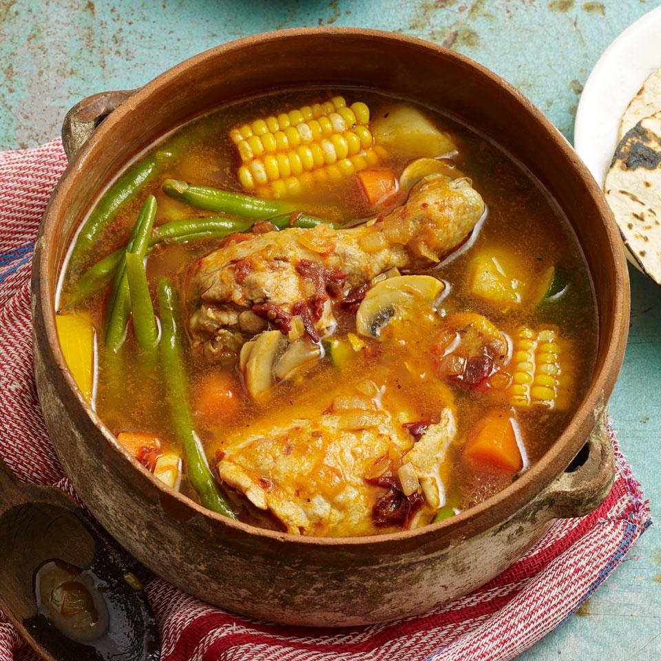 Chipotle-laced broth and thick chunks of corn on the cob are featured in this healthy, smoky chicken soup recipe. The secret to the great flavor is cooking the vegetables in the broth that's made from cooking the chicken. Serve the soup with warm corn tortillas.