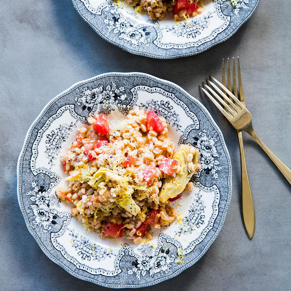 Here farro stands in for rice in a risotto-like dish, full of tomatoes, artichokes and fresh basil.