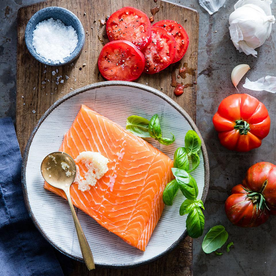 This recipe is so beautiful and yet so simple to prepare--it's perfect for entertaining. You just spread a side of salmon with minced garlic, sprinkle with fresh basil, then layer sliced tomatoes on top. Put it on the grill for 10 minutes and you're done! Source: EatingWell Magazine, July/August 2010