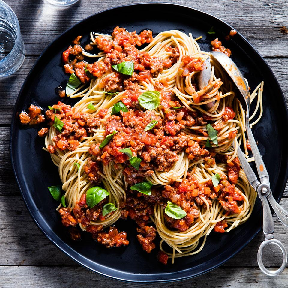 Instead of opening a jar of sauce, try this easy spaghetti with meat sauce on a weeknight. Serve with steamed broccoli and garlic bread. The recipe makes enough for 8 servings. If you're serving only four for dinner, cook 8 ounces of spaghetti and freeze the leftover sauce. Source: EatingWell Magazine, November/December 2010