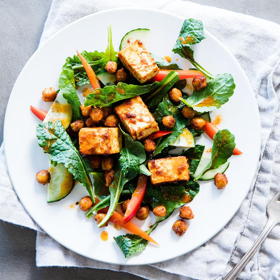 To top this zesty raw kale salad recipe, we toss diced tofu and chickpeas with a flavorful Moroccan-inspired spice mixture before roasting. The hot oven turns the outside of the tofu crisp and the inside pleasantly chewy.