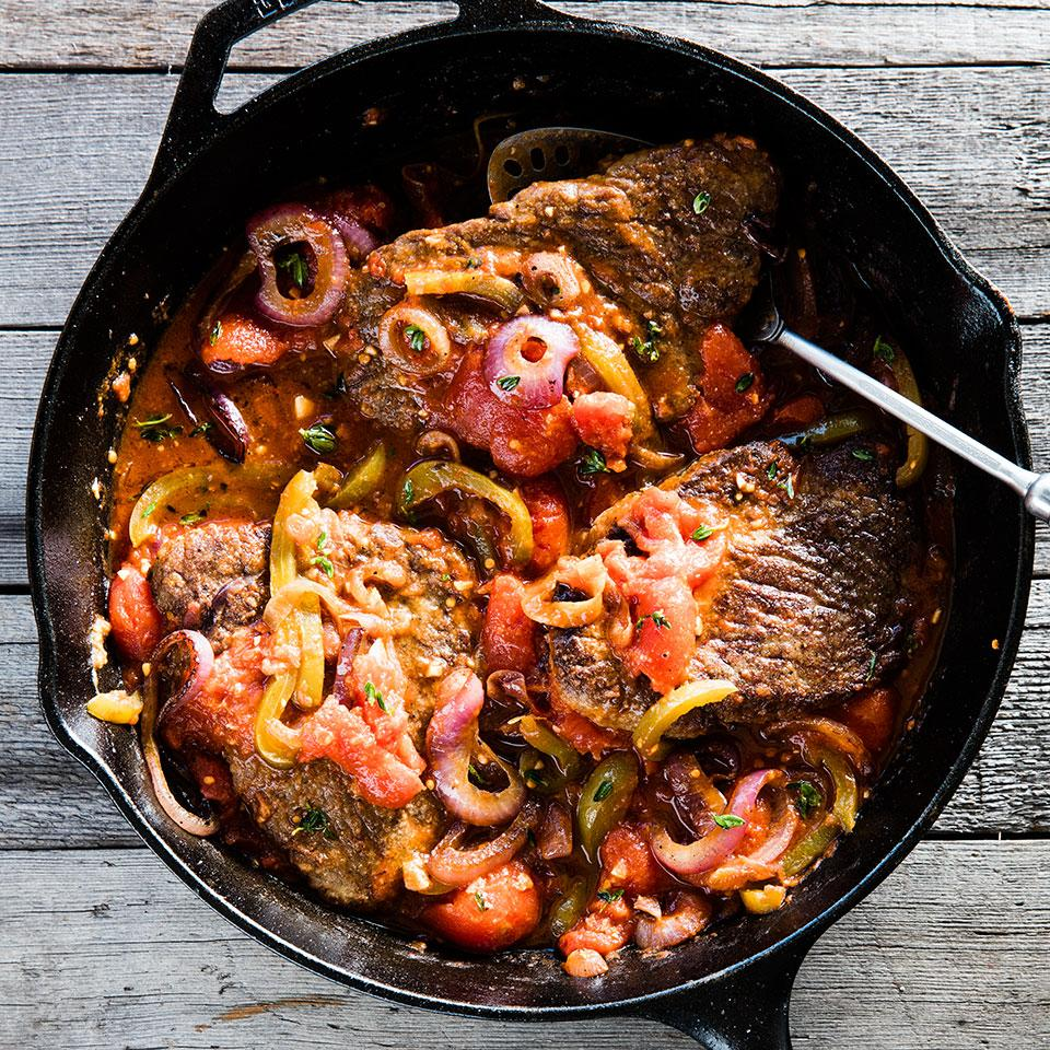 This weeknight-fast Swiss steak recipe is made on the stovetop in just 30 minutes (traditional Swiss steak braises in the oven for an hour or more). Sautéed peppers, onions and tomatoes make a quick, savory sauce. Ask your butcher for 4 equal-size cube steaks (about 4 ounces each) so they cook evenly. Source: EatingWell Magazine, November/December 2014