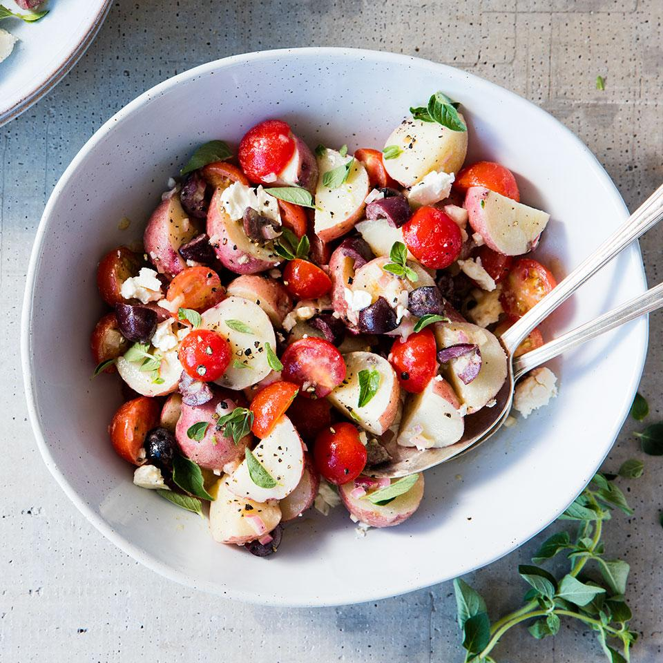 In this healthy potato salad recipe, a white-wine vinaigrette dresses the potatoes, tomatoes, feta and olives. Waxy potatoes, such as red and yellow, make the best potato salad because they hold their shape when cooked. Keep the potato skins on for more fiber and potassium. Source: EatingWell Magazine, July/August 2015