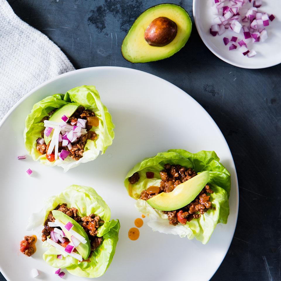 Don't limit yourself to lettuce for this low-carb, gluten-free taco lettuce wrap recipe--any fresh green sturdy enough to wrap around 1/2 cup of filling works. Source: EatingWell Magazine, March/April 2016