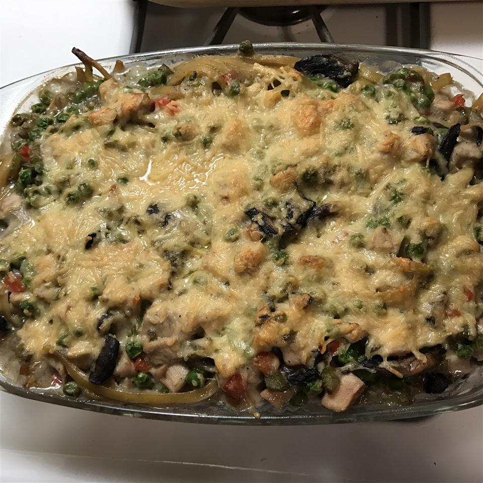 Home cooks have added asparagus, leeks, broccoli, and extra red bell pepper to sneak more veggies into this rich casserole.