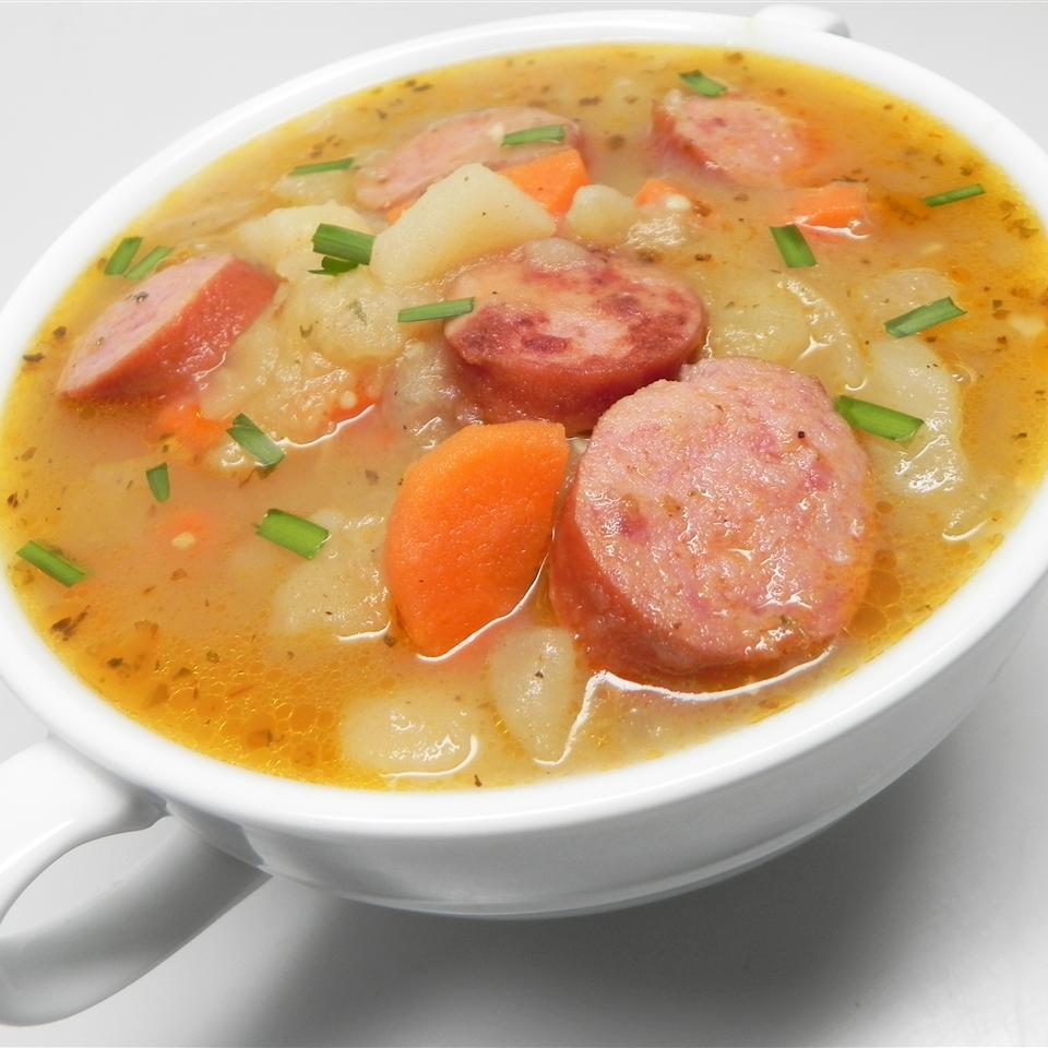 """Loaded with vegetables and sausages, this classic Bavarian-style potato soup is a complete meal. """"In Germany the sausage of choice would be Regensburg sausage, a short and stubby parboiled pork sausage,"""" says Marianne. """"It can be substituted with other boiling sausages made of pork."""""""