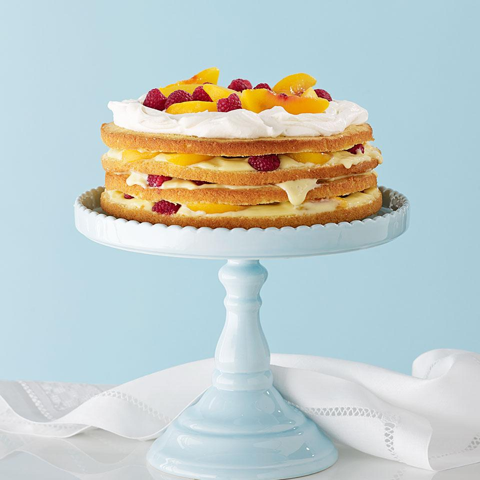 Lightly poached peaches, fresh raspberries and creamy vanilla custard fill the layers in this trifle-inspired healthy cake recipe. Impressively tall and luscious, this four-layer cake can be tricky to cut. For neater slices, you can assemble two shorter (two-layer) cakes instead. Source: EatingWell Magazine, May/June 2014